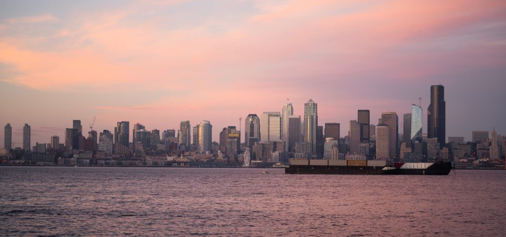 pink sunset cargo ship puget sound downtown seattl P29DUZY