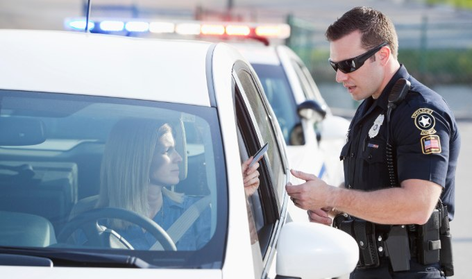 woman getting ticket from police officer gettyimages 680x402 1